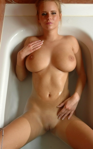 Busty blonde in bath