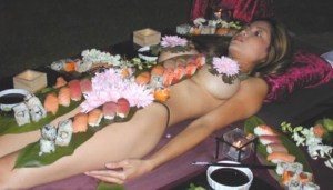 naked babe with sushi on her