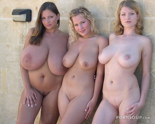 Topless group of women with big tits around pool
