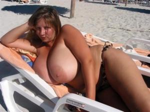 Massive Boobs On The Beach