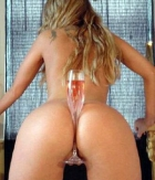 champagne glass in ass